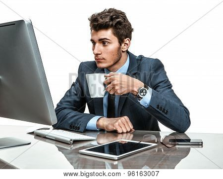 Young Office Clerk Having A Coffee Time In Office Sitting At The Table
