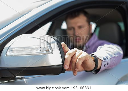 Handsome young man is driving his vehicle