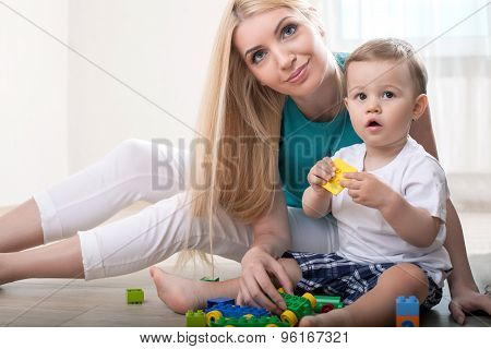 Beautiful young mother is spending time with her child