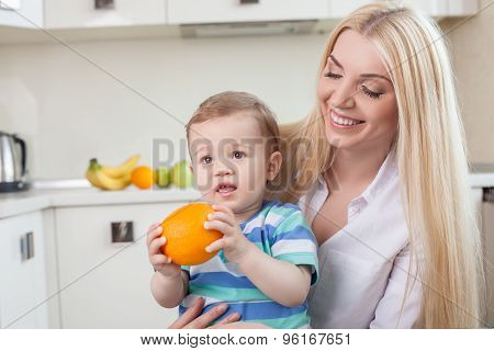 Cute family are eating fruits in the kitchen