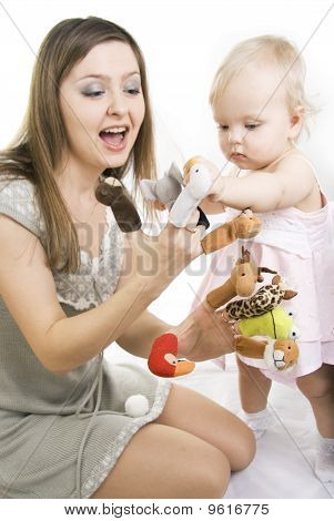 Mother And Daughter Playing With Finger Puppets.