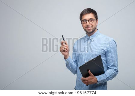 Cheerful young male manager is doing his job