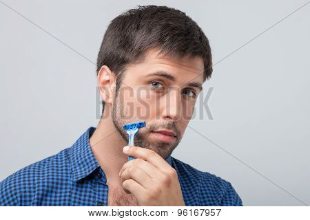 Handsome young guy is preparing for date