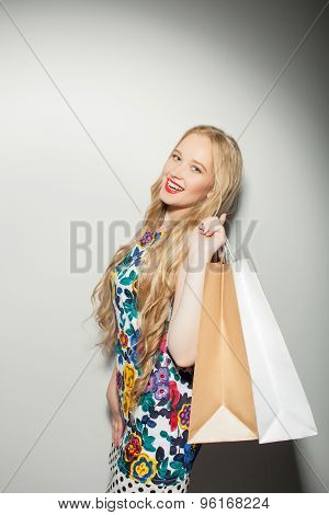 Cheerful young healthy woman is going shopping