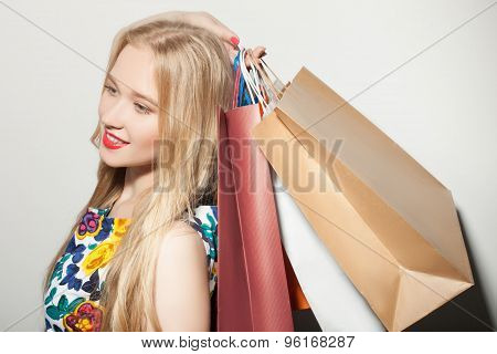 Cute young blond woman is purchasing with pleasure