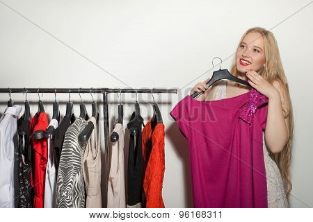Pretty young girl is shopping in boutique