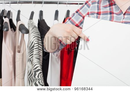Young styled woman is shopping in store