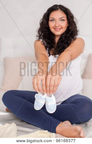 Pretty young pregnant woman with childlike clothing