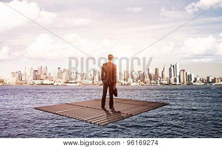 Businessman Standing On Raft