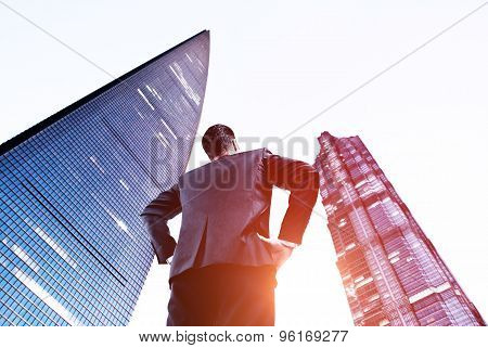 Man Looking On Skyscraper