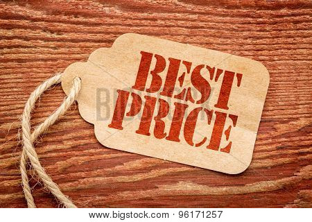 best price sign a paper price tag against rustic red painted barn wood - marketing concept