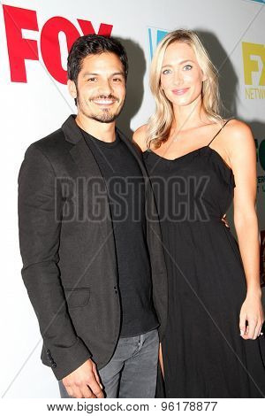 SAN DIEGO, CA - JULY 10: Nicholas Gonzalez and guest arrive at the 20th Century Fox/FX Comic Con party at the Andez hotel on July 10, 2015 in San Diego, CA.