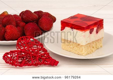 A piece of strawberry cheesecake on the wooden background.