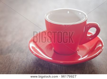 Red Coffee Cup On Wooden Table