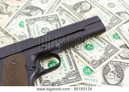 Gun On Money Texture Background.
