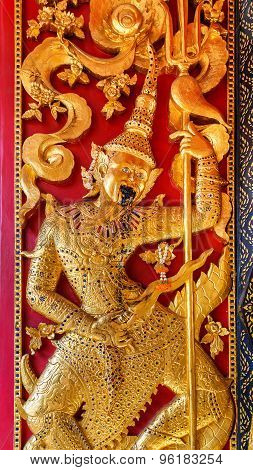 Low Reliefe on the door at Wat Bovorn (Bowon) Nivet Viharn in Bangkok Thailand