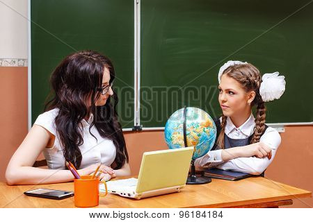 Teacher And Pupil In Geography Class.