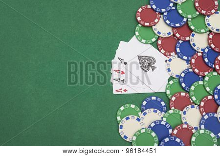 4 Ace Of Pokers Beside Lots Of Chips On Casino Table