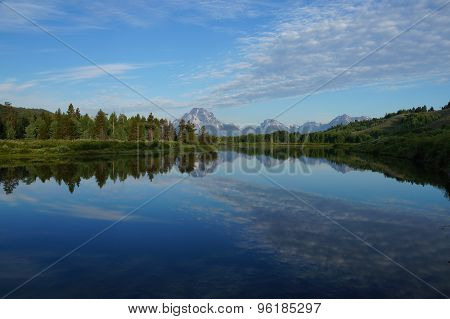 Snake River reflecting the Rocky Mountains and the sky