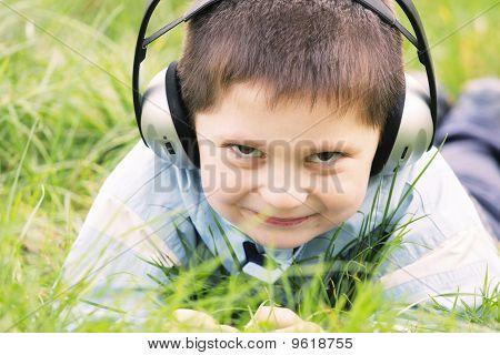 Smiling Boy In Headphones Outdoors