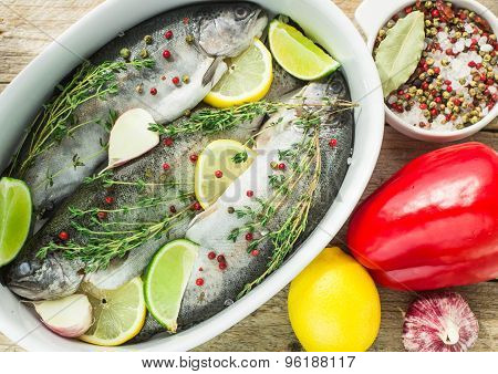 Three raw rainbow trout with spices