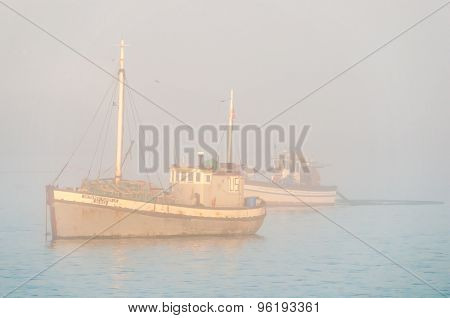 Fishing Boat In Thick Mist