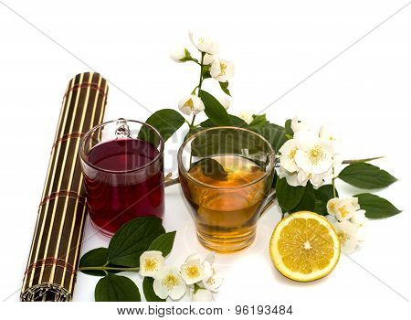Two Glasses Of Drink And Lemon On A White Background