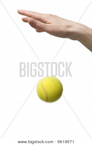 hand and tennis ball