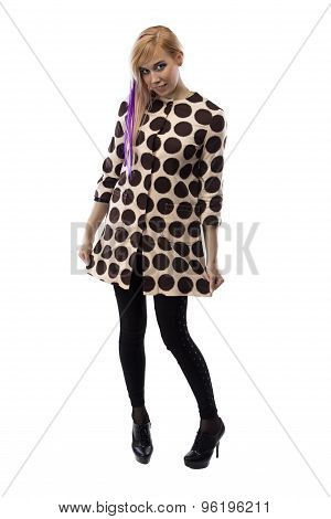Smiling woman in spotted coat, chin down