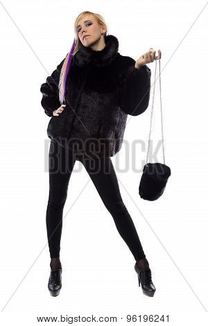 Image of woman with fur bag, hand up