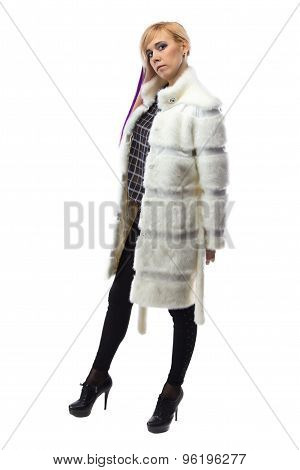 Photo of blonde in white unbuttoned fur coat