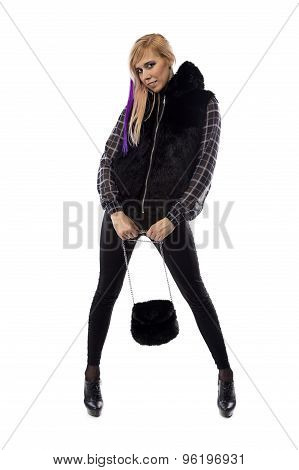 Photo of blonde with fur bag, chin down