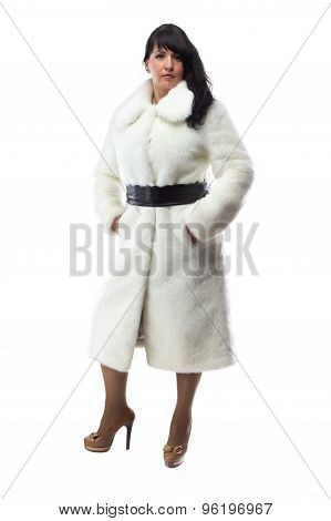 Image of pudgy brunette in long white coat