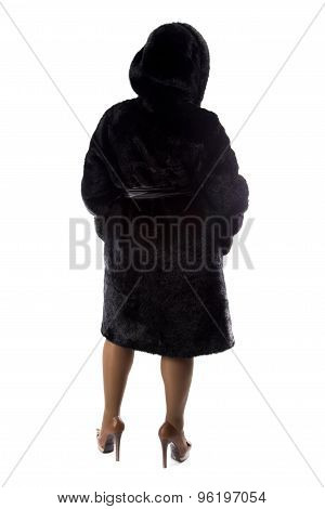 Pudgy brunette in coat, from back
