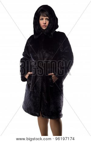 Photo of brunette in black fur coat