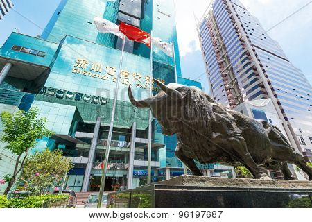 Shenzhen,China-June 15,2015: Shenzhen stock market building and bull sculpture