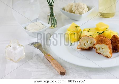 Fork In Front Of Portion Of Breaded Cauliflower