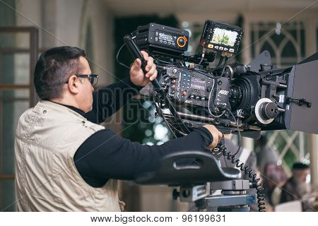 Camera operator working during filming