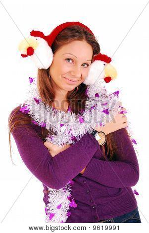 The girl in fur ear-phones on a white background.