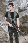 foto of rifle  - Handsome young man soldier with a rifle - JPG