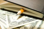 pic of memento  - notebook with a blank sheet pencil and money on the old tissue - JPG