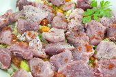 stock photo of condiment  - Meat slices with condiments ready for cooking - JPG