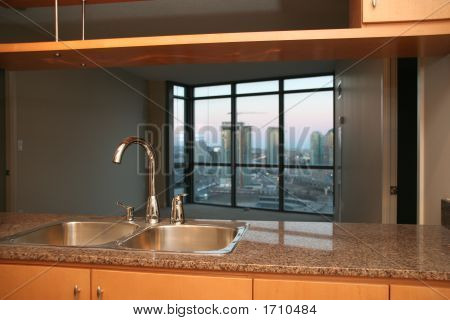 Small Condo Apartment Kitchen With Sink And Tap And Marble Counter Tops
