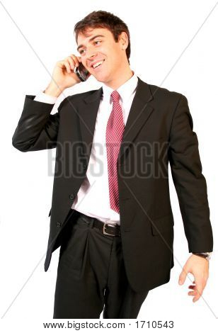 Business Man Talking On The Cell Or Mobile Phone Through His Pda Making A Deal Smiling And Happy