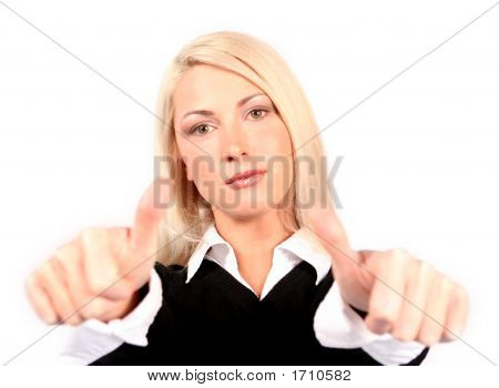 Two Thumbs Up From A Young Attractive Blond Business Woman In A Black And White Shirt Showing Approv