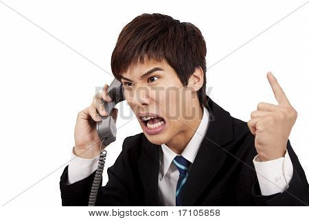 angry businessman screaming on the phone and isolated on white background