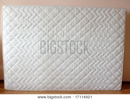 white mattress on the room