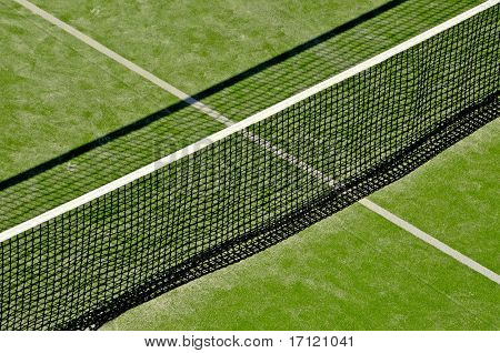 closeup of a tennis court with the net at the front