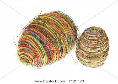 Colorful straw easter eggs isolated over white background