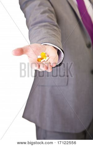 Man in suit with pills